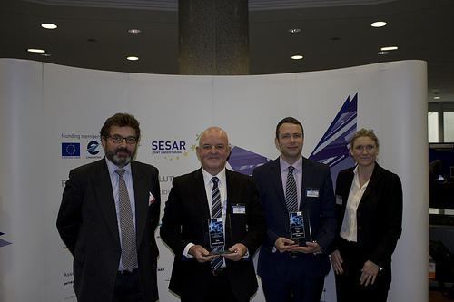 NATS' Tony Vaudrey and Kevin Loy with Alex Brooker, Snowflake Software and Lisa Sullivan of Harris, collecting their awards at the SESAR SWIM Master Class 2013.