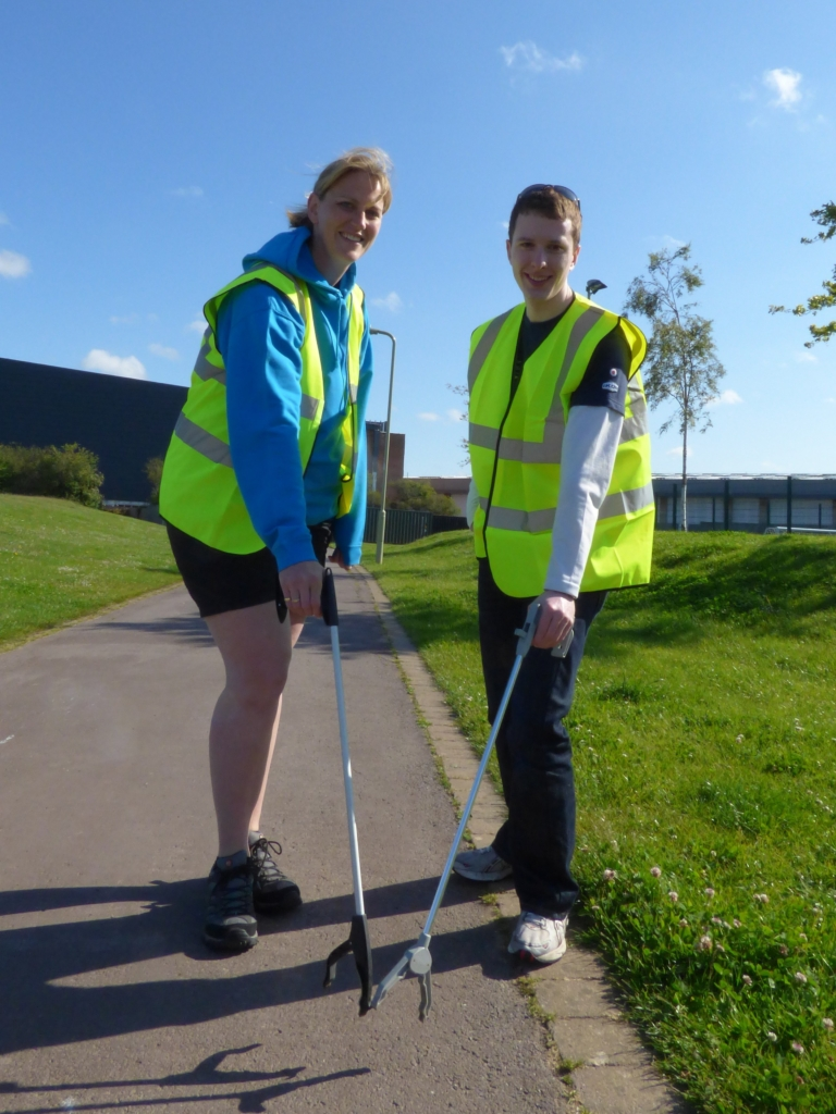 Vicky Newhouse, Engineering Manager for the Early Careers Scheme at NATS, and Placement System Engineer Jonathan Marmont picking litter in Whiteley